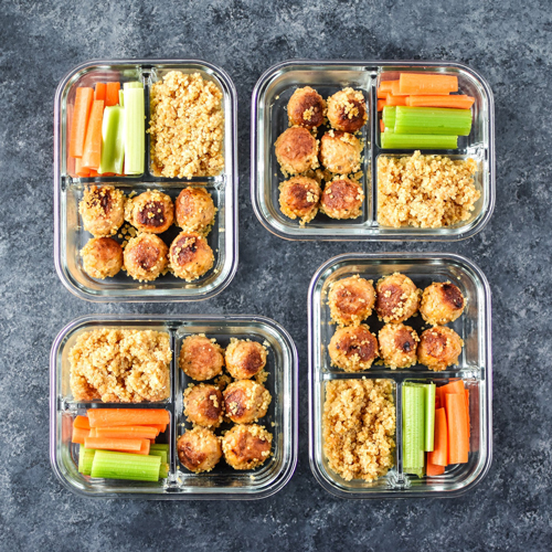Buffalo chicken meatballs, quinoa, celery and carrot sticks in meal prep containers