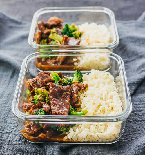 Instant pot beef and broccoli with rice in a square meal prep container