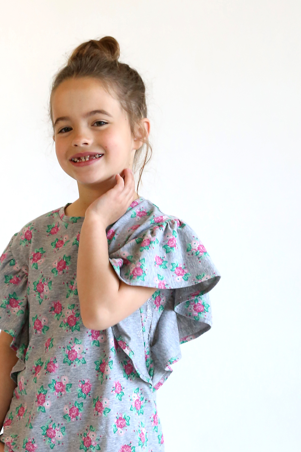 Click through for this adorable free sewing pattern for a girls top in size 7/8. Cute girls ruffle shirt pattern free!