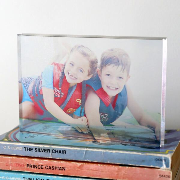 DIY Acrylic photo block on a stick of books