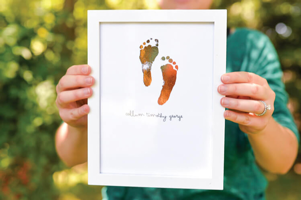 Adorable foiled footprint sign | 30 best handprint and footprint projects