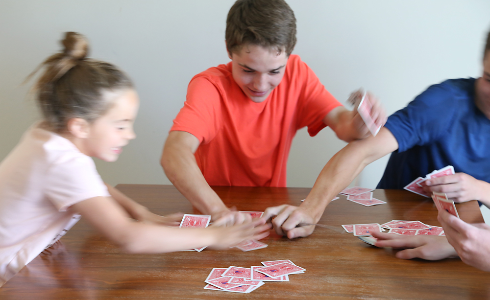 kids having fun playing spoons card game