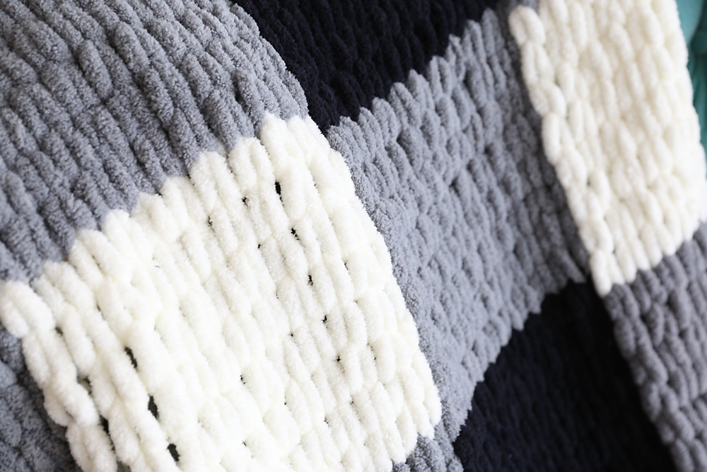 A close up of a finger knit blanket
