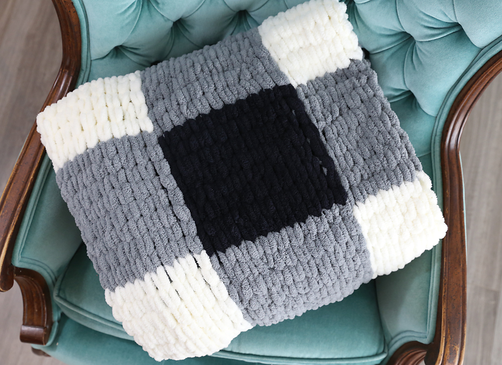 Loop yarn blanket folded on a chair