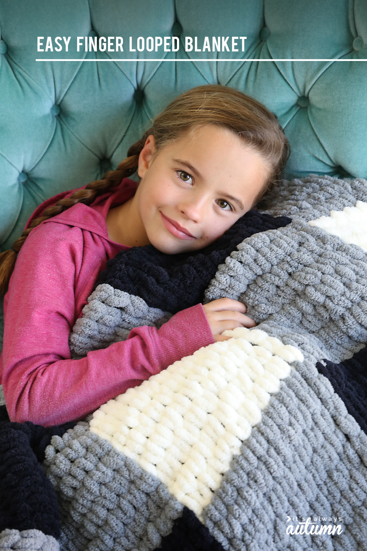 Girl snuggling with handmade blanket