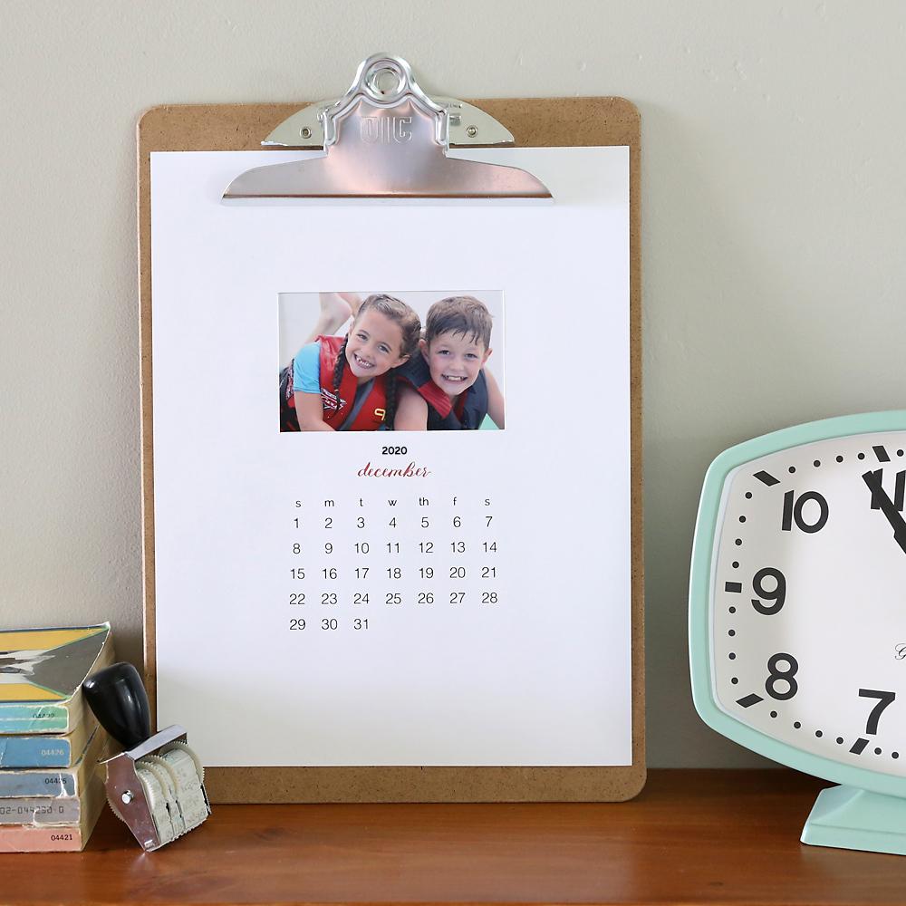 Photo calendar on a clipboard