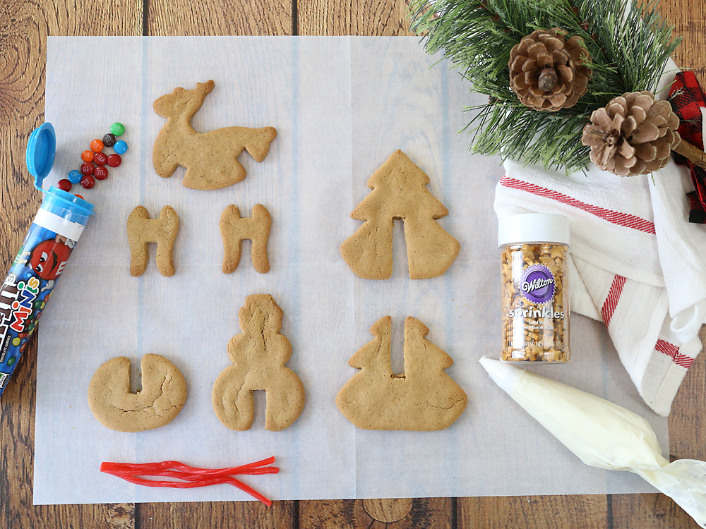 3D gingerbread cookie pieces with frosting and decorations