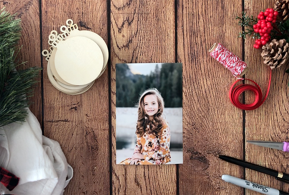 Unfinished wood ornaments, photo of a girl, twine, ribbon