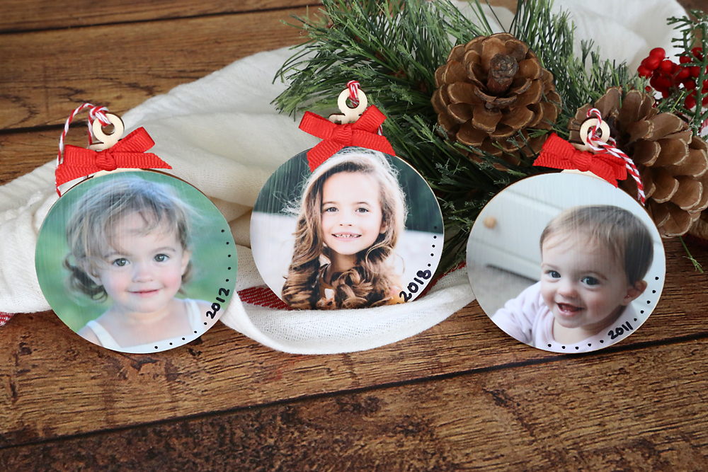 DIY photo ornaments with pictures of a little girl, one for each year