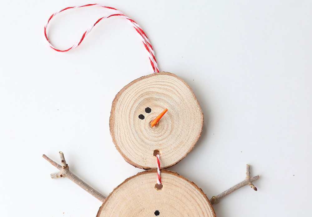 End of toothpick glued onto the snowman ornament for a nose