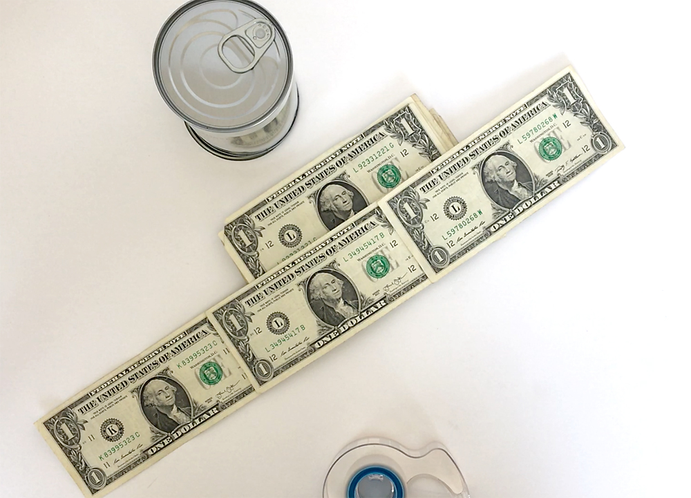 One dollar bills taped together into long row of money