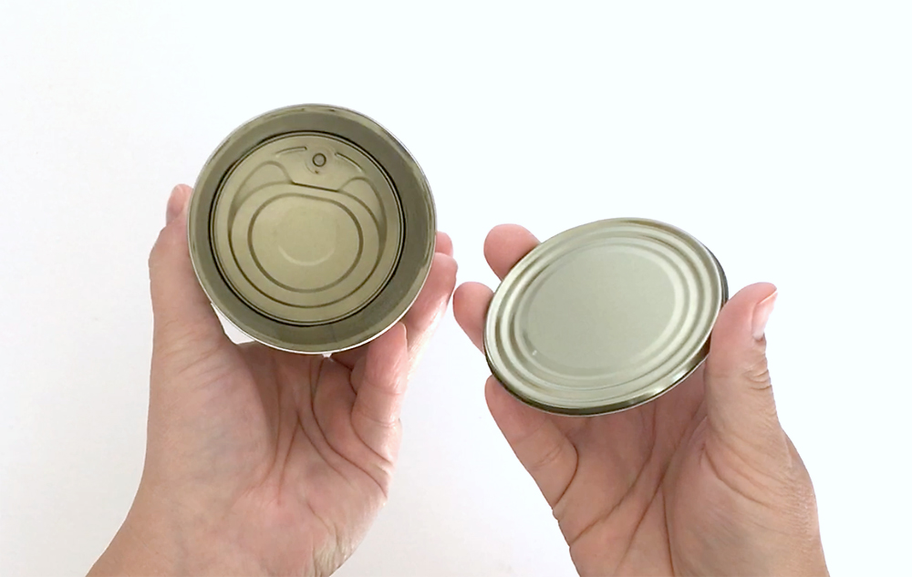 A pop top can with the bottom removed and inside cleaned out
