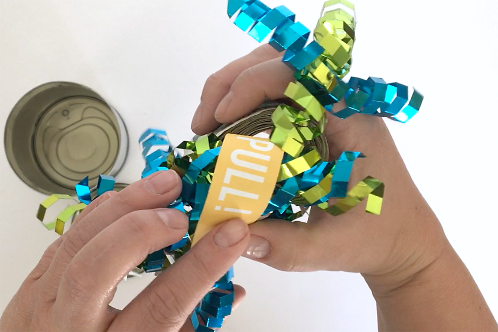 Hands holding roll of money with ribbon on top