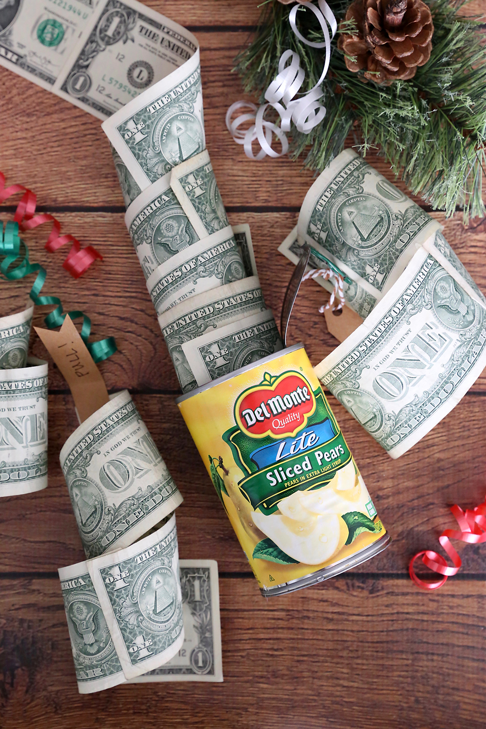 Roll of one dollar bills inside a can of pears