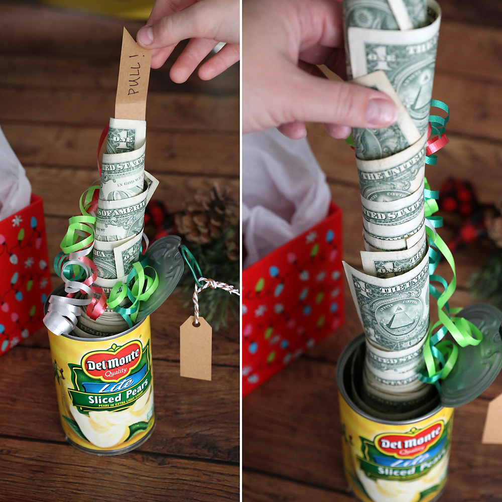 Hand pulling the tag to show a roll of cash