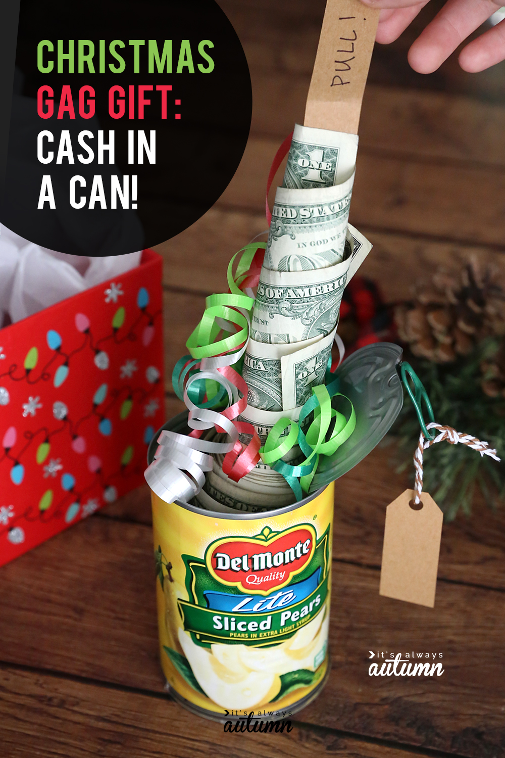 Christmas cash in a can gift, with roll of money coming out of a can of pears