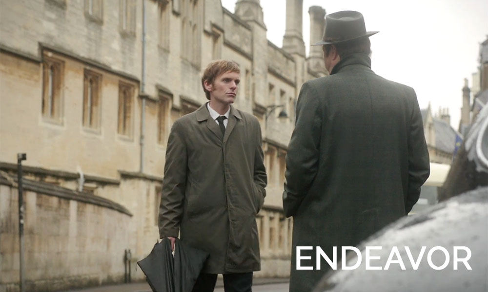 Two detectives standing in a road in Endeavor