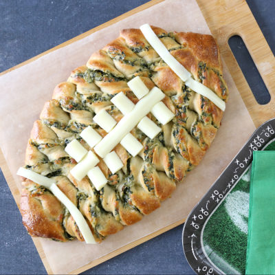 Football shaped spinach dip breadsticks for the big game!
