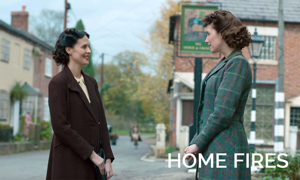 Two women talking in the street in the movie Home Fires