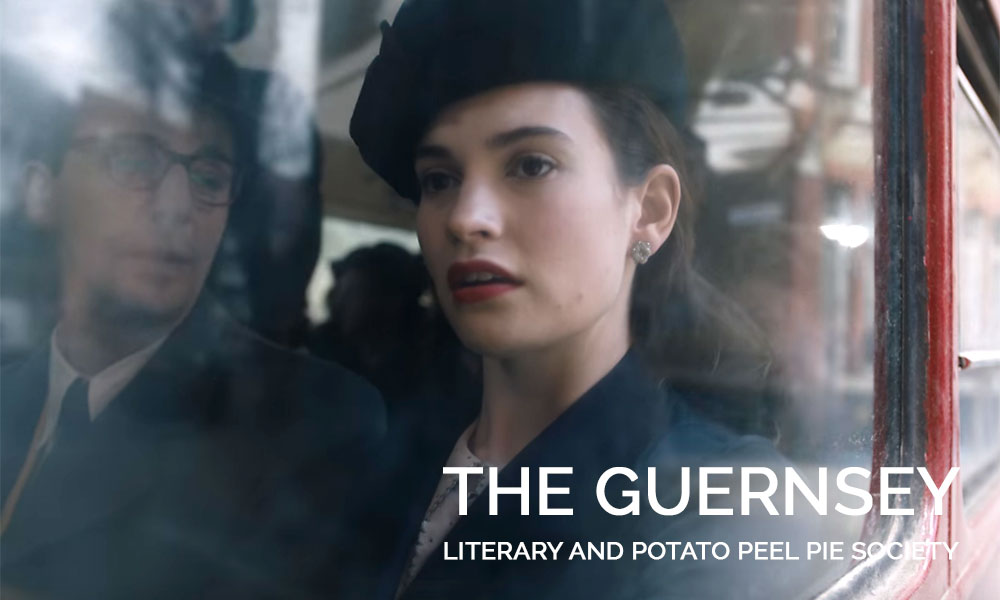 A close up of Lily James wearing a hat in The Guernsey Literary and Potato Peel Pie Society