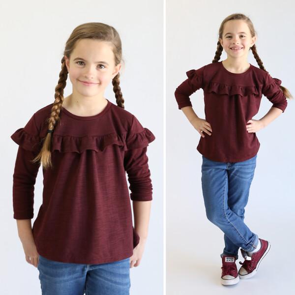 Girl wearing ruffled t-shirt made from free sewing pattern