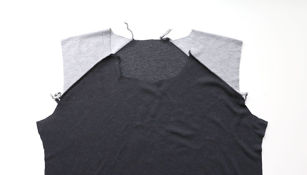 Shirt with shoulder pieces sewn to front and back
