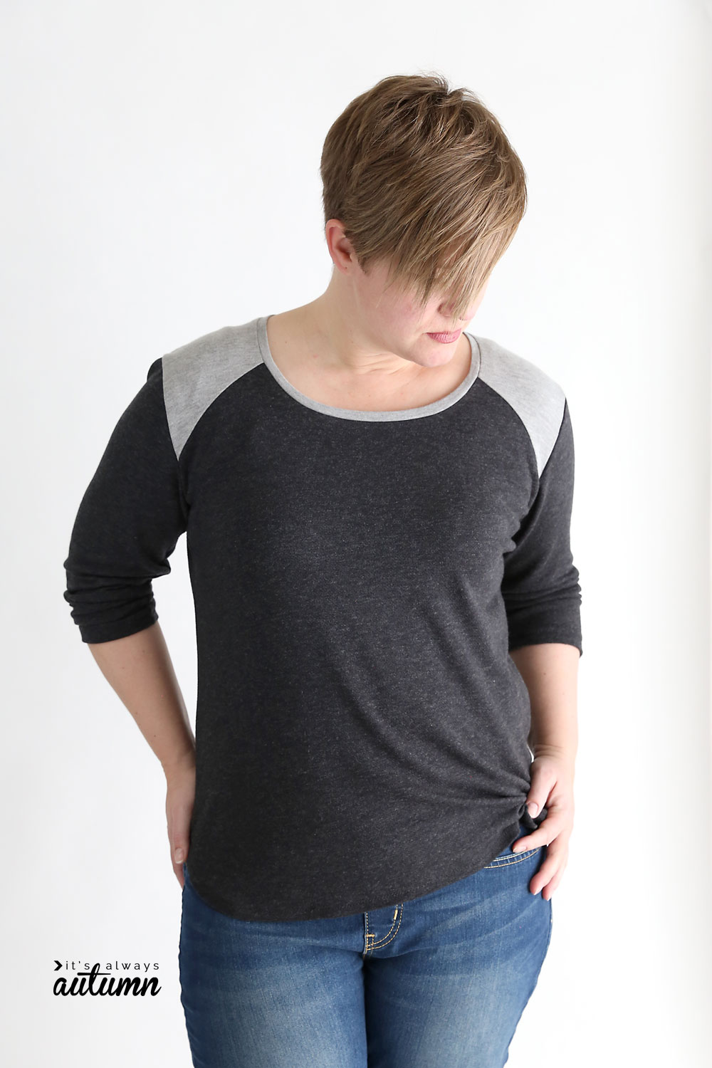 Woman wearing long sleeve t-shirt with contrast shoulder panels