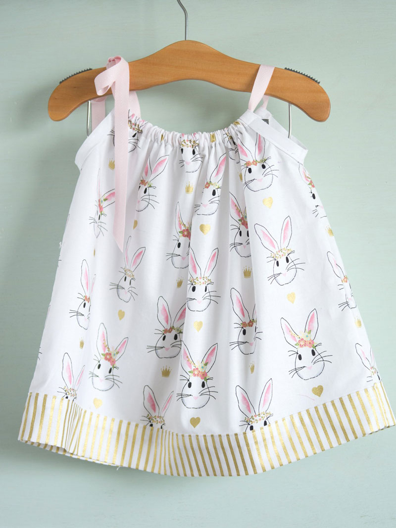 Baby pillowcase dress on a hanger