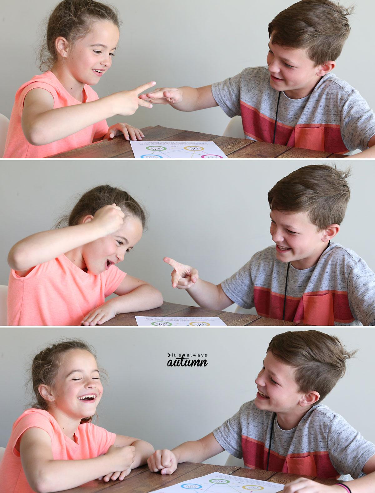 Little kids playing rock paper scissors
