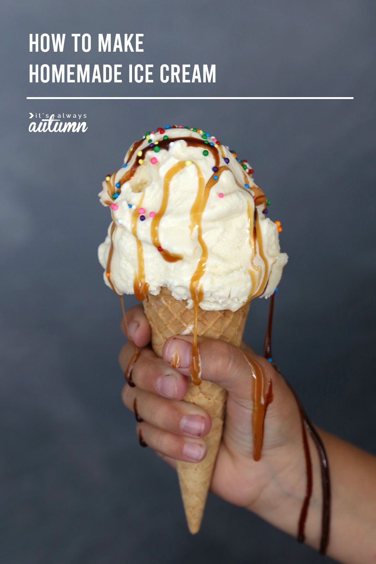 Hand holding a vanilla ice cream cone with chocolate and caramel syrup and sprinkles