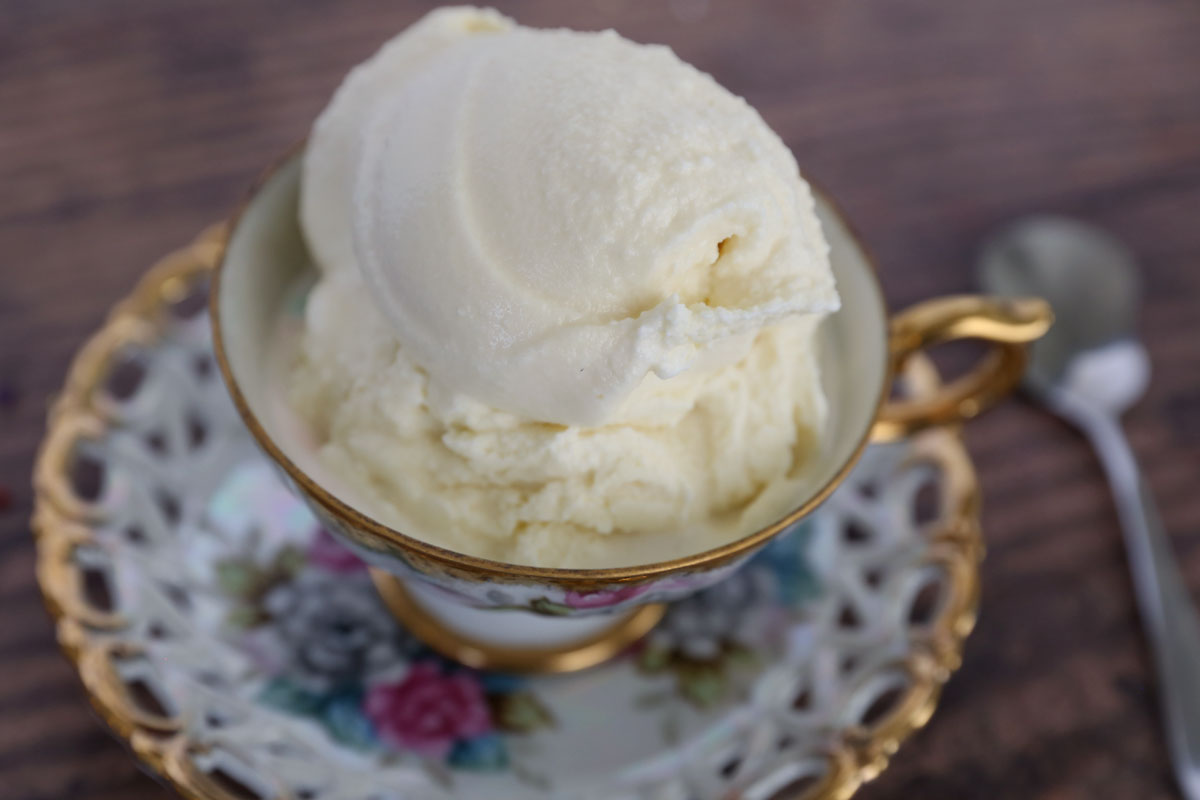 Scoop of old fashioned vanilla ice cream in a teacup