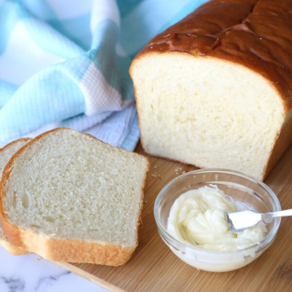 Loaf of bread sliced with butter