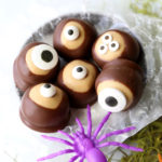 Peanut butter balls dipped in chocolate and topped with candy eyes