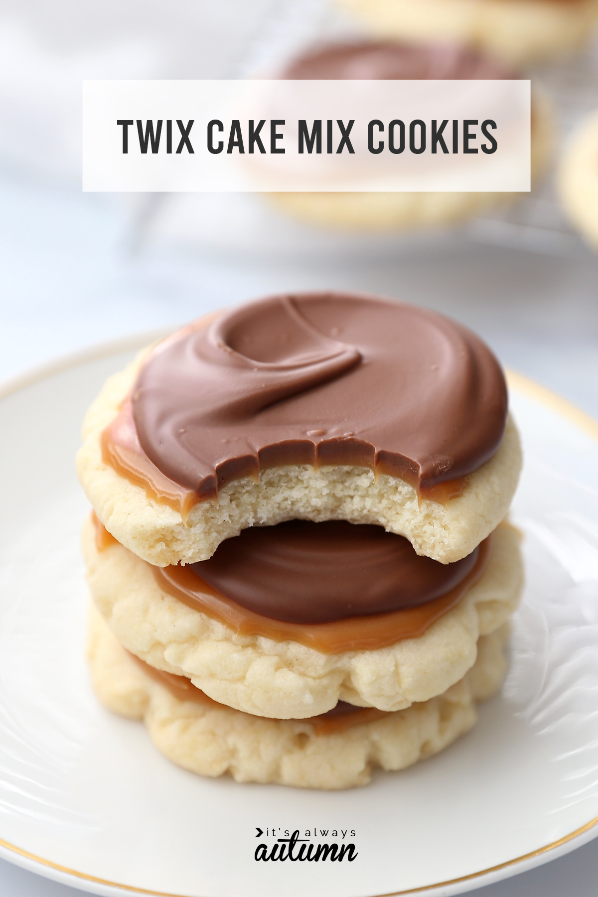 A stack of Twix cake mix cookies with a bite taken out of the top cookies