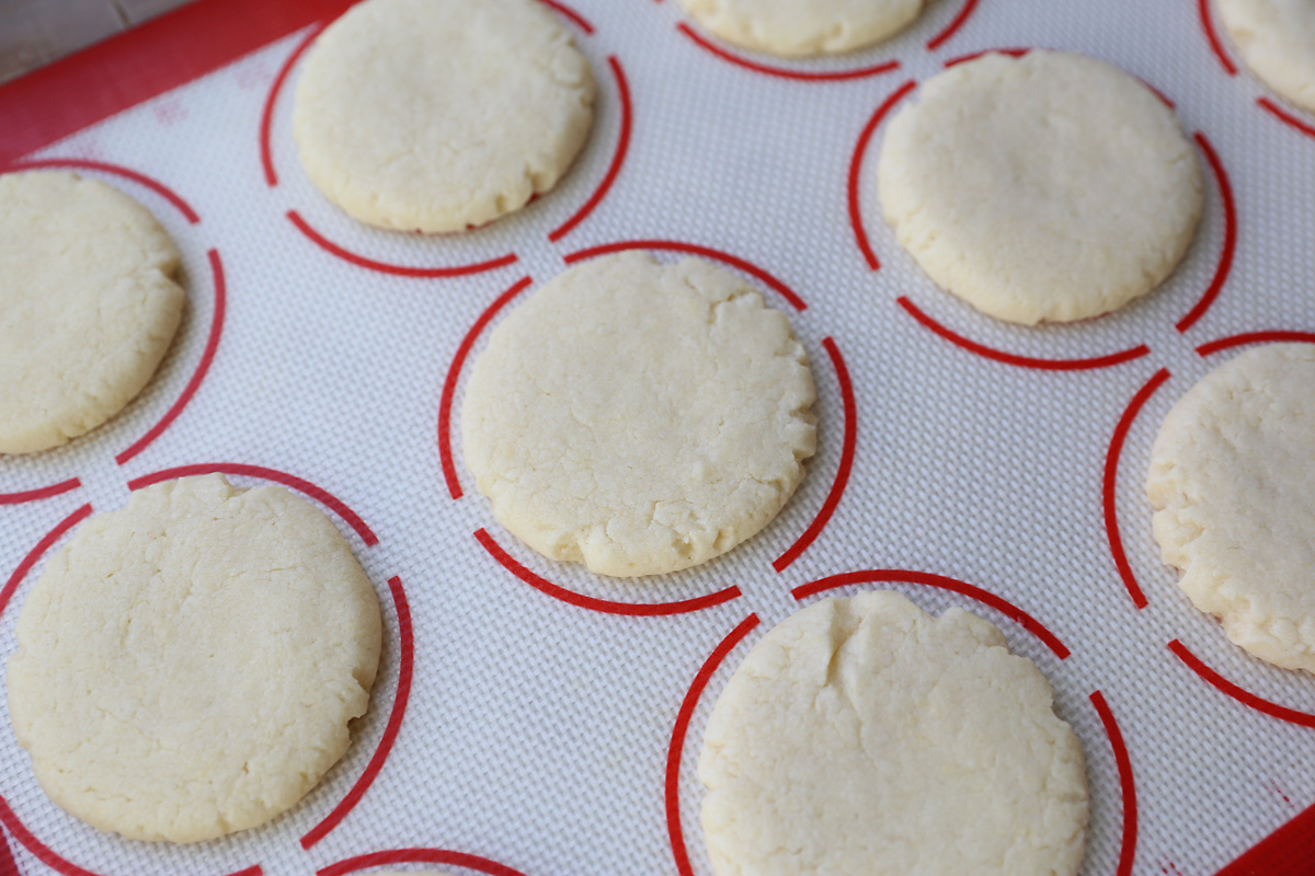 Baked sugar cookie on a cookie sheet liner
