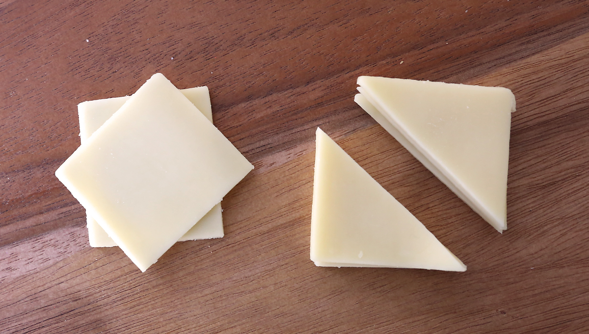 Cheese squares cut diagonally into triangles