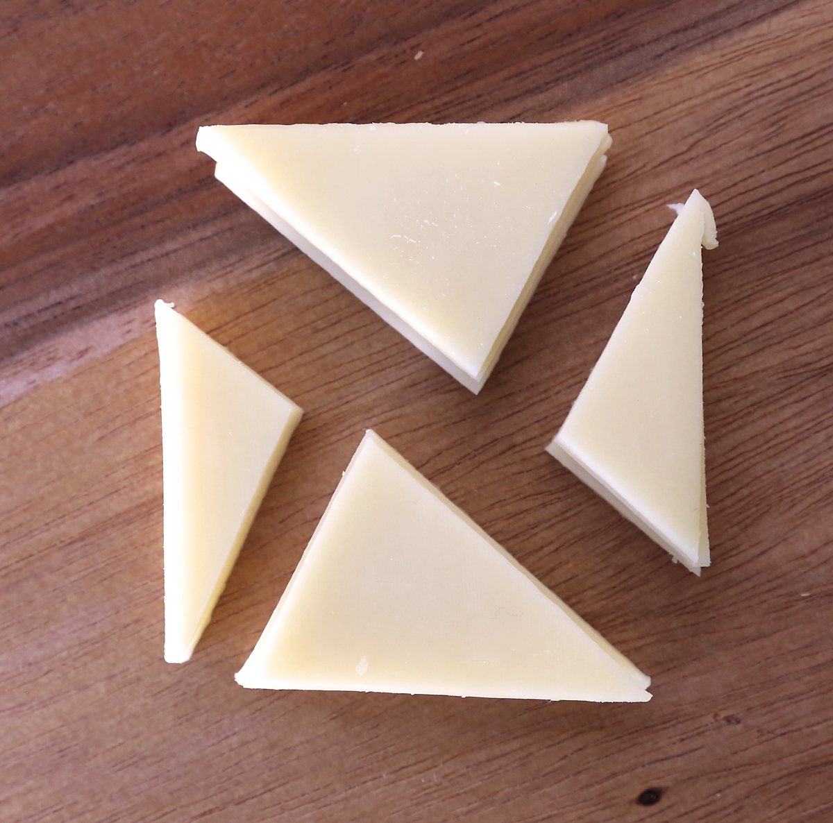 Cheese triangles cut again into small triangles