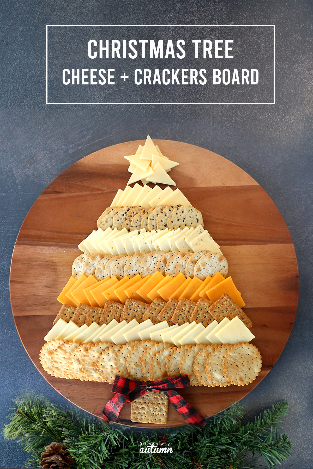 Cheese and crackers in the shape of a Christmas tree on a wood tray