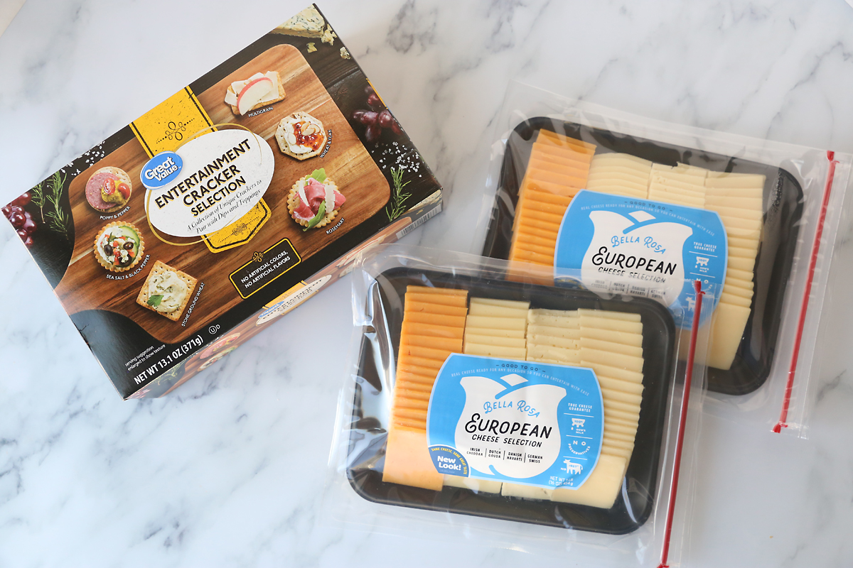 Package of variety crackers and packages of variety cheese slices