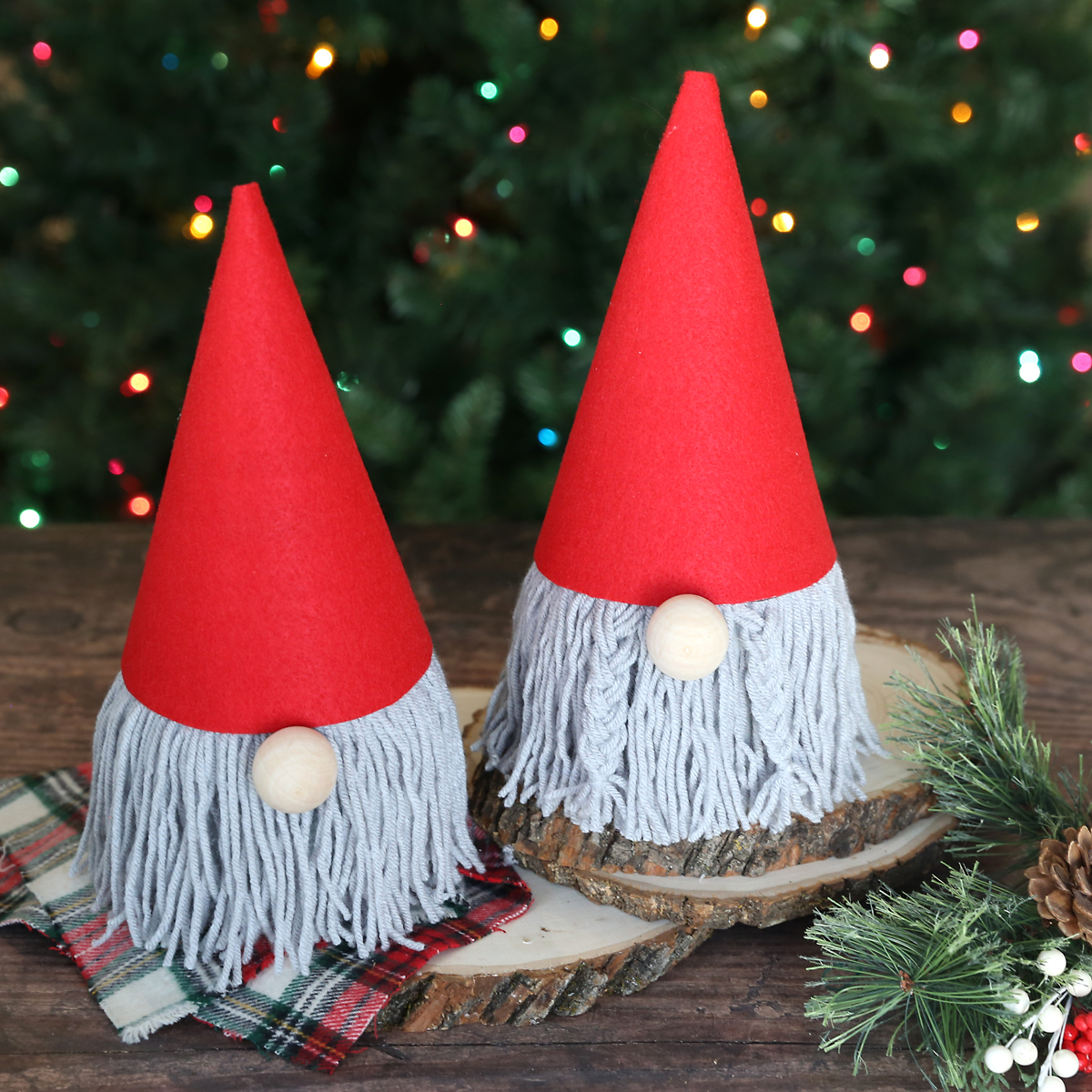 Christmas gnomes made from toilet paper roll with yarn beard and red felt hat