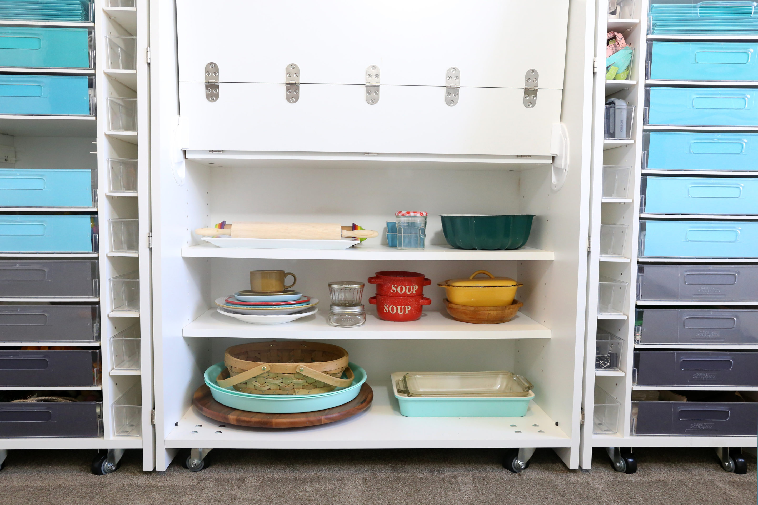 Bottom shelving on a DreamBox full of dishes
