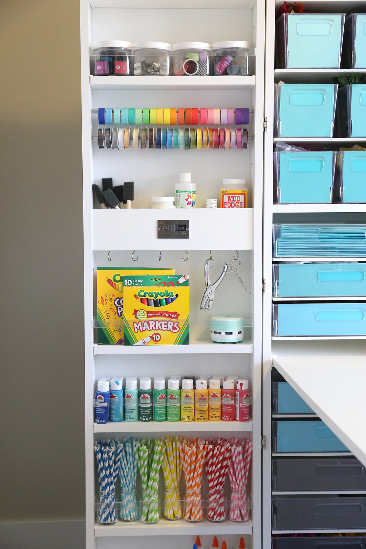 A close up of one door of a DreamBox holding various colored craft supplies