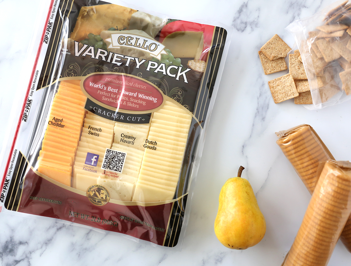 Variety pack of cheese with crackers and pear