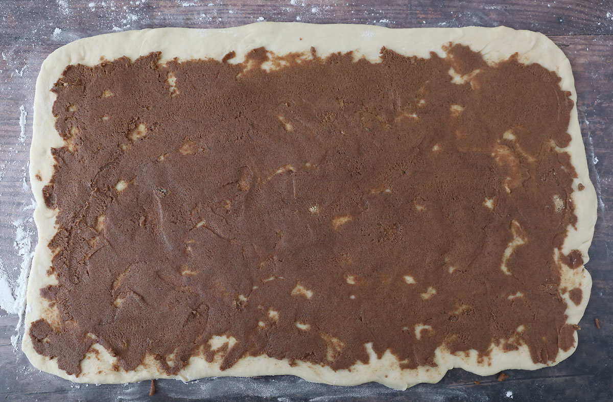 Cinnamon sugar filling spread over dough