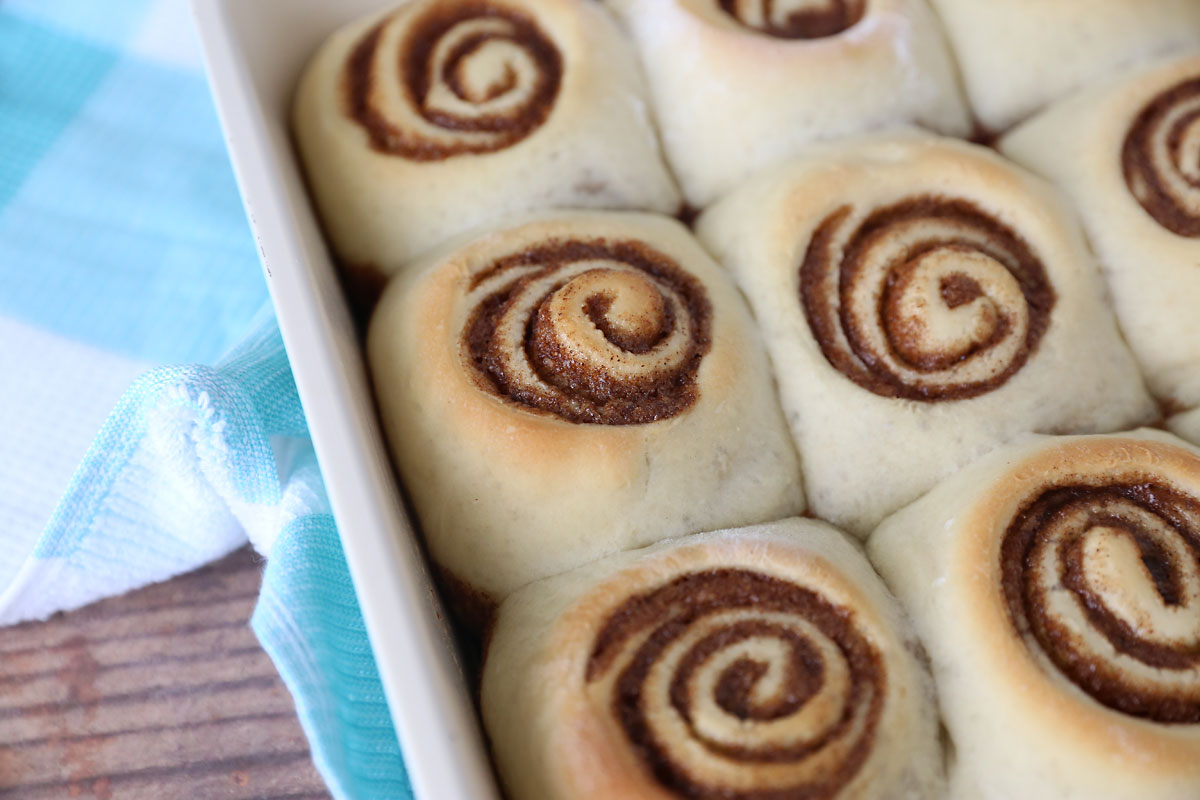 When baked, cinnamon rolls are golden brown on top