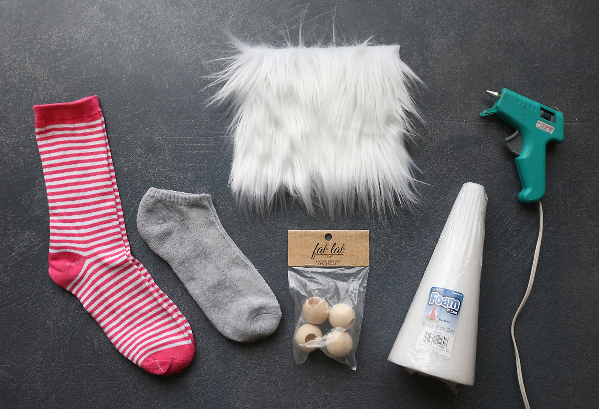 Sock gnome supplies: Foam cone, faux fur, wood bead, plain sock, patterned sock