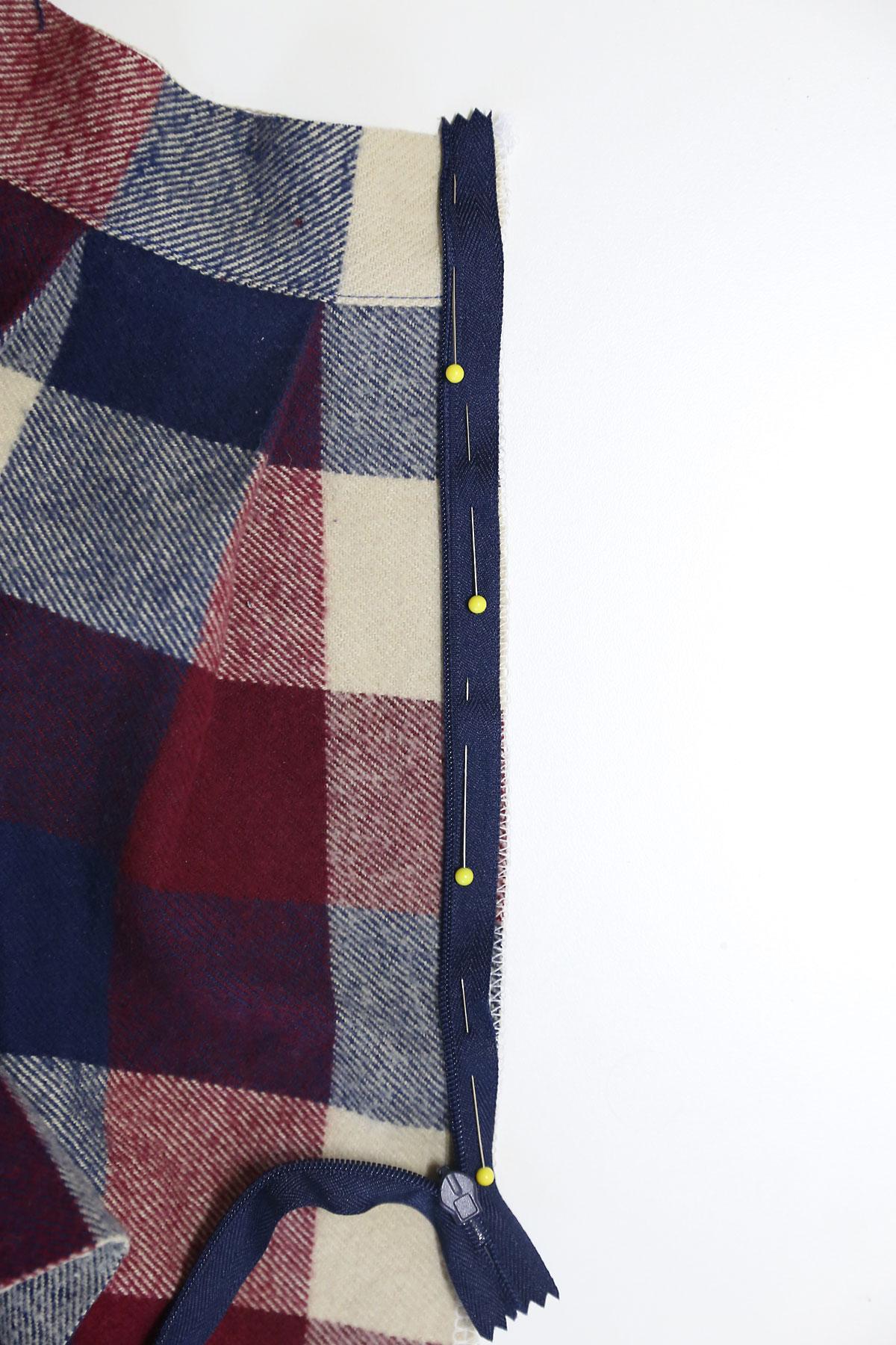 Zipper pinned to raw edge of skirt