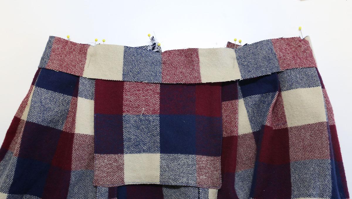 Waistband facing pinned over skirt