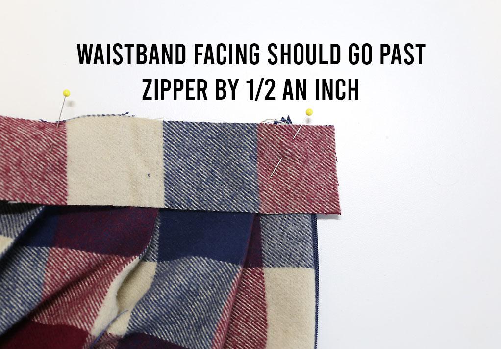 Waistband facing extends past zipper by 1/2 an inch