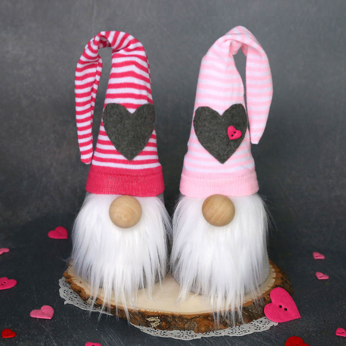 Two sock gnomes with pink striped hats with hearts on them for Valentine\'s Day